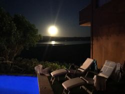 Pool area at full moon with lake view