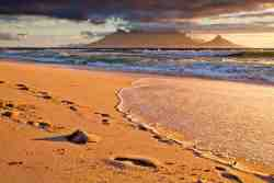 Table Mountain at dusk off Blouberg Beach Front. Follow the foot prints