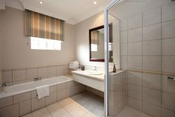 Full En-Suite Bathroom, with separate bath and shower.