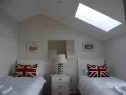 Second bedroom with two single beds.  Bath and beach towels provided.  Hair dryer.