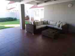 Outdoor braai (barbeque) and breakfast area.  Under cover carport.  Private enclosed garden.