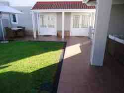 Private enclosed garden with outdoor braai, breakfast area and carport.