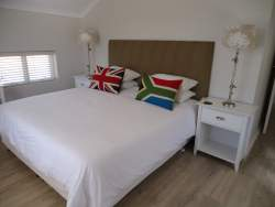 Main Bedroom with king sized bed.  Bath and beach towels provided.  Electronic safe.  Hair dryer.