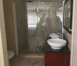 Main bathroom on suite with big walk in shower and double basins.