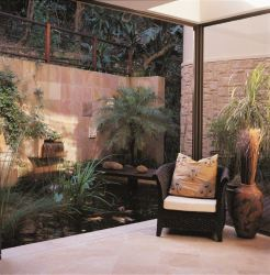 Lounge with open sliding doors leading onto the koi pond.
