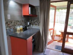 The Cottage kitchenette & private garden seating