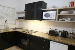 Fully Equipped Kitchen with Electric Stove and Microwave.