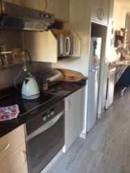 Self catering kitchen -fully equipped with stove,oven,microwave,fridge & freezer