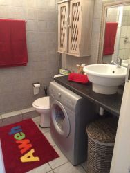 Bathroom with shower & washing machine installed