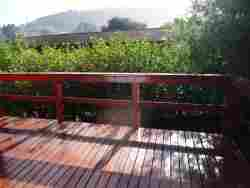 2 Dune Park, Keurboomstrand.  Front deck leading into private garden and built-in braai (barbecue).