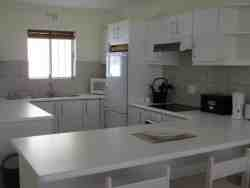 Open plan, fully equipped kitchen.