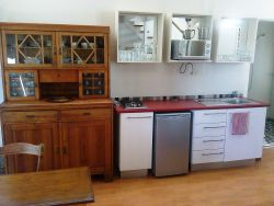 Fully equipped Kitchenette, 2 plate gas stove and under counter refrigerator