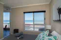 Master Bedroom view onto balcony and ocean