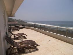 Huge wraparound balcony with views up uninterrupted views up and down the coastline.