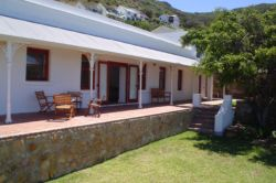 Delightful self-catering four bedroomed cottage with magnificent sea and mountain views.