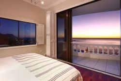 Main ensuite bedroom with spectacular views.  Closing white blinds.