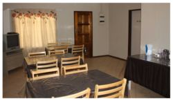 Communal Dining & TV Room with DSTV, Fridge & Microwave.