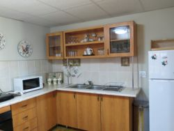 Unit 8- A Cherry Pie has a fully equipped open plan kitchen with microwave, under counter oven, two plate induction cooker, toaster, frying pan etc.