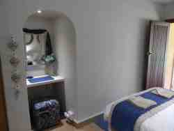 This room has a double bed with en-suite shower and toilets, coffee/tea facilities, bar fridge, microwave and  32