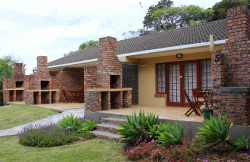 Entrances to units 2-5 indicating braai / BBQ facilities.