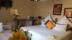 . Lux Double bed room with extra single bed. Flat screen TV, fridge and micowave