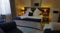Lux Double bed room with extra single bed. Flat screen TV, fridge and micowave