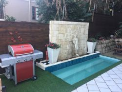 Entertainment patio with private swimming pool and gas braai