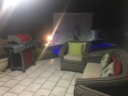 Patio and swimming pool at night