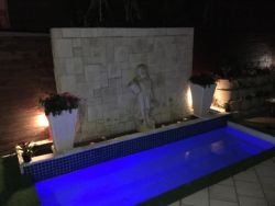 Swimming pool and water feature wall during night