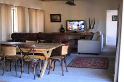 Amandari Lodge with open plan dining tv and kitchen