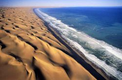 The Atlantic Ocean meets the Namib Desert's dunes