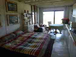 Interior of cottage with twin beds made up as double