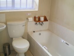 En-suite bathrooms, most rooms with full bath and shower.