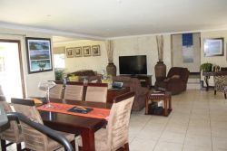 Diningroom and two lounge areas with full DSTV.