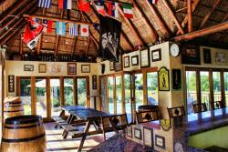 Inside thatched bar area with full DSTV.