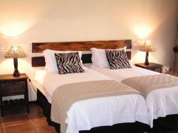 Luxury double bedroom with twin beds. En-suite bathroom and private access to garden.
