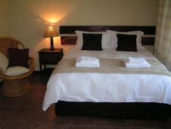 Luxury double bedroom with queen bed and en-suite bathroom.
