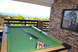 Pool table on patio by living area
