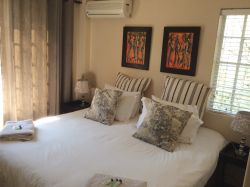 Mian bedroom with king size bed. There is a/c, fan, heater and BIC