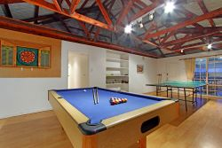 Games room with darts, pool table and table tennis.