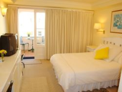 Room 3 Mezzanine level. Comfortable with standard double bed. Own balcony with side sea views