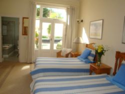 Room 1 Ground floor twin three quarter beds. Private patio, no sea views