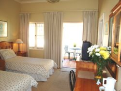 Room 4 First Floor. Spacious with twin three quarter beds. Side sea views from large balcony.