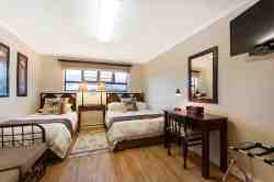 Double bed plus single bed. Satellite TV, kitchenette, private entrance, bathroom with shower.