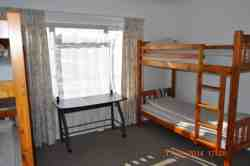 Apartment 1A - sleeps 4 in bunk beds.