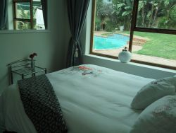 Baileys place bedroom with pool view