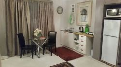 Own kitchenett with dinig table ,microwave and fridge