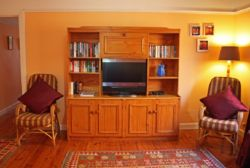 Lounge, TV, Bookshelf.
