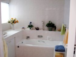 Full bathroom with bath, shower & wash basin