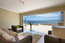 The 2nd lounge flows onto a generous sun deck where you can suntan or braai (barbecue) while overlooking the sea.